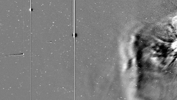 An image from NASA's STEREO-A spacecraft, showing ISON on the left, Mercury and Earth as two lens-flare spots, and a coronal mass ejection, or flare, from the Sun on the right
